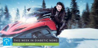 Man in coat and scarf rides red snowmobile