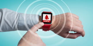 finger pointing to smart watch with blood drop displayed on it