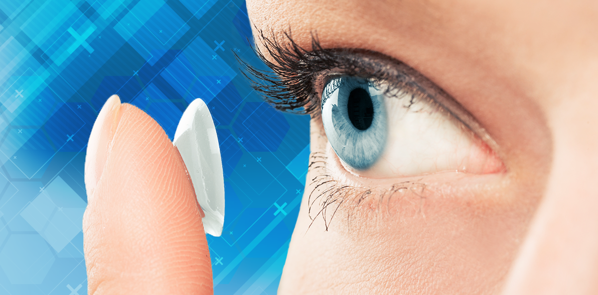 woman putting contact in her blue eye, blue background