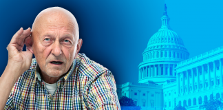 man cups hand behind ear over blue background with capitol building
