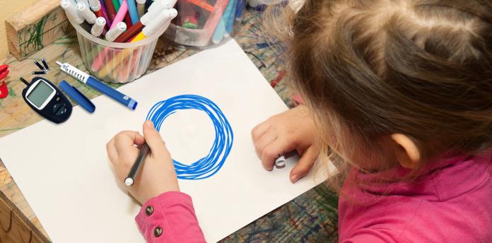 little girl coloring, diabetes management tools