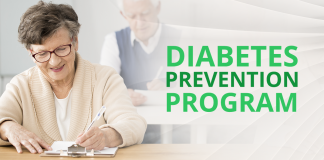 woman signing paper with diabetes prevention program beside her