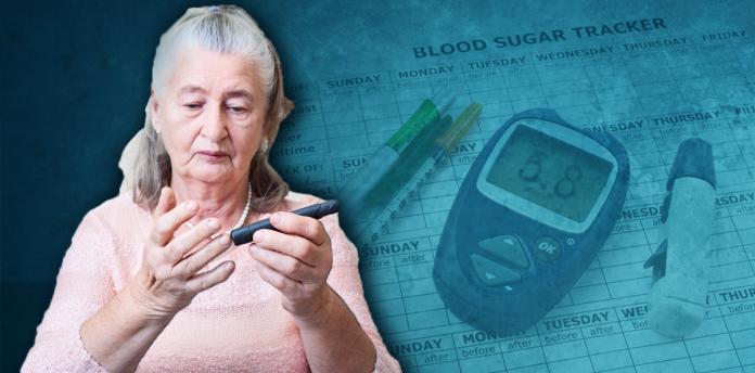 woman with grey hair checking blood sugar