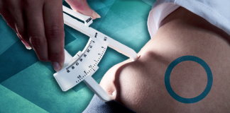 tool measuring body fat with diabetes symbol on skin