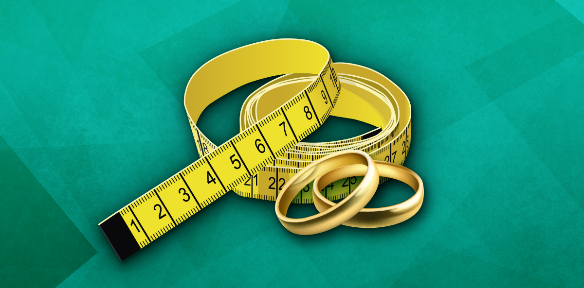 yellow tape measure over green background