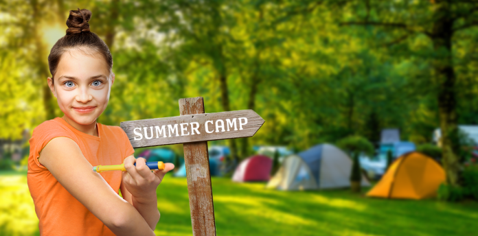 diabetes summer camp, girl standing in front of summer camp sign