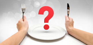 the prediabetes diet, hands holding fork and knife with red question mark over white plate