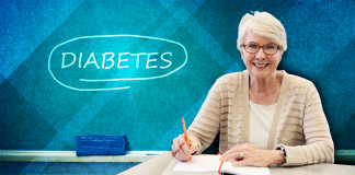 woman sits at desk over blue-green background; 10 things you might not know about diabetes