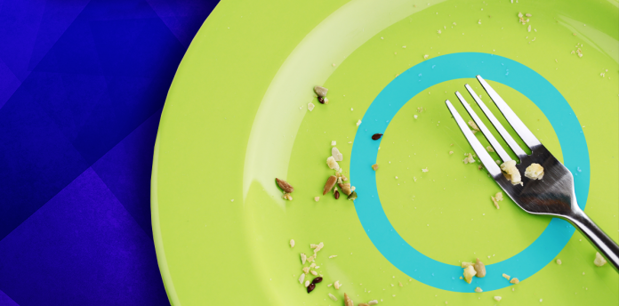 plate showing crumbs and fork with diabetes symbol over blue background