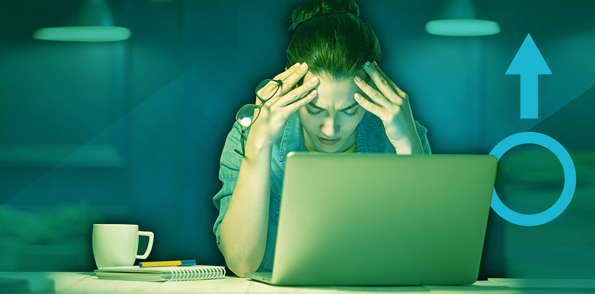 woman working at laptop over blue background; women working overtime could increase diabetes