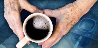 hands holding coffee cup over blue background