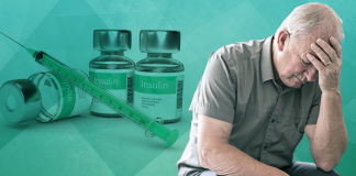 man with head in hands sitting beside insulin; insulin resistance