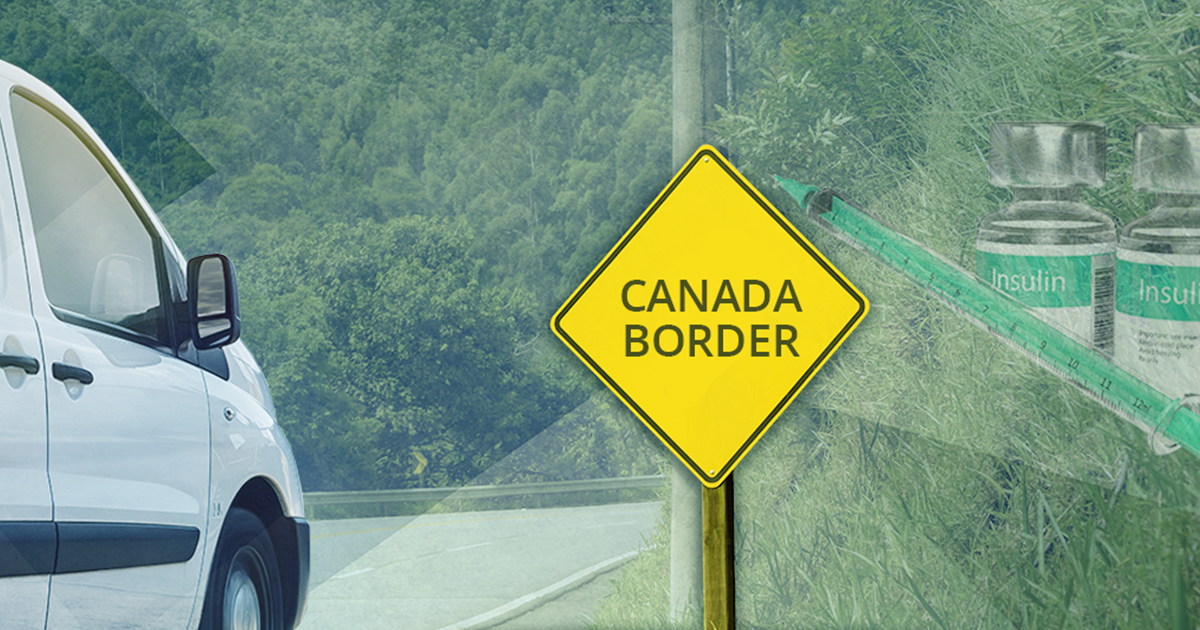 sign reading canadian border with van