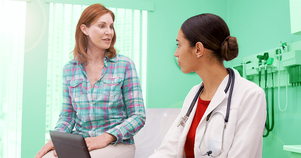 early menopause, perimenopause, menopause, diabetes, premature menopause, woman at doctor talking to doctor